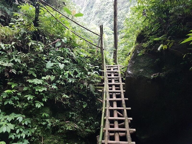 Tangga Bambu Di Atas Batu Besar